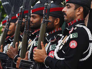 In pic: Pakistani Rangers march during a flag hoisting ceremony to celebrate Pakistan's Independence Day on the Pakistan-India border at Wagah on August 14, 2015.