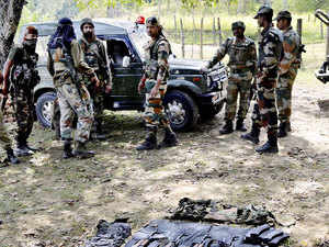 In pic: Army personnel inspecting arms and ammunition recovered after an encounter in which four militants and an Army Jawan were killed, in Kupwara district of Kashmir.