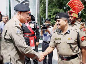 In pic: Pakistan Rangers Director General (Punjab) Major General Umar Farooq Burki is received by BSF IG Anil Paliwal in Attari on September 9, 2015.