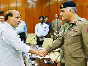 Union Home Minister Rajnath Singh shakes hands with Pakistani Rangers Director General (Punjab), Major General Umar Farooq Burki during a meeting on Friday.