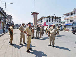 In pic: Police personnel stand guard at Lal Chowk during restrictions imposed by the authorities to maintain law and order following a strike call given by Traders.