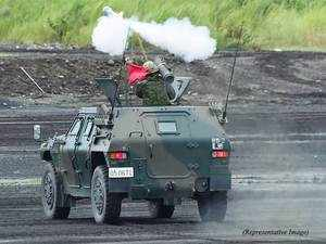 (In Pic): A Japanese Ground Self-Defense Force soldier fires an anti-tank missile from an armoured personel carrier during an annual live fire exercise at the Higashi-Fuji firing range in Gotemba, at the foot of Mount Fuji in Shizuoka prefecture on August 18, 2015.