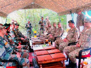 In pic: Indian Army and Pakistan Army Officers during a Brigade Commander level Flag Meeting at the Chakan Da Bagh, in Poonch on September 21, 2015.