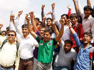 Hardik Patel, a popular leader of Patidar farming caste group, shout slogans.
