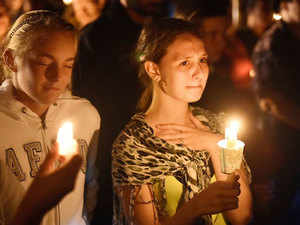 A young woman reacts during a vigil in Roseburg, Oregon, for ten people killed and seven others wounded in a shooting at a community college in the western US state of Oregon. The shooter -- identified by US media as Chris Harper Mercer, 26 -- opened fire in a classroom at Umpqua Community College in rural Roseburg, then moved to other rooms methodically gunning down his victims, witnesses said.