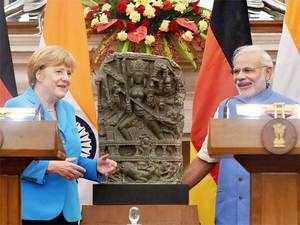 "India and Germany agreed to work together to reach an ""ambitious"" climate agreement in Paris later this year and stressed that adaptation must be a central part of a balanced accord."
