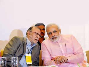 (Left) Professor Anil Baijal and (Right) Prime Minister Narendra Modi