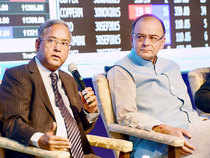 UK Sinha, Chairman of SEBI and Union Finance Minister, Arun Jaitley during an event announcing the FMC-SEBI merger in Mumbai.