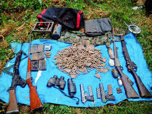 In pic: Security Forces recover arms and ammunition from a militant's hide out in Gubbar forests in Doda on Sepetember 22, 2015.