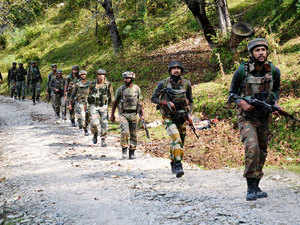 In pic: Army soldiers take positions at Hafruda forest in Kashmir's Kupwara district,during a gunfight with militants on October 5, 2015.