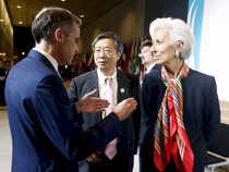 German Bundesbank President Jens Weidmann, People's Bank of China Deputy Governor Yi Gang and IMF Managing Director Christine Lagarde (L-R) talk after a family picture of the G-20 group at the 2015 IMF/World Bank Annual Meetings in Lima, Peru. Gang is reported to have told the annual meeting that China's stock market has experienced several rounds of correction.