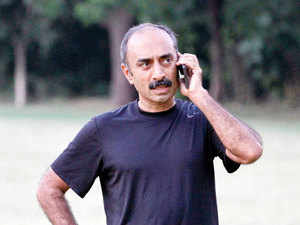 Sanjiv Bhatt, Indian officer with the intelligence bureau in the western state of Gujarat during the 2002 riots, speaks on his mobile phone in Ahmadabad, India.