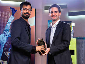"""ET awards is celebrating entrepreneurship aptly, at a time when we need more entrepreneurs to emerge and build a vibrant India like never before."" (In Pic: Ankit Bhati, Ola, Cofounder drives away with his ""Oscar"" presented by Evan Spiegel)"