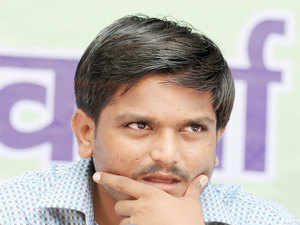Sporadic protests took places at few places in Gujarat while one state transport bus was set on fire following detention of Hardik Patel.