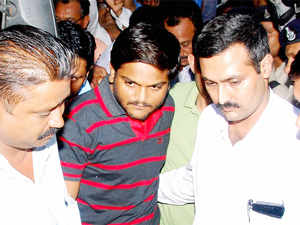 Hardik Patel being produced in a fast track court.