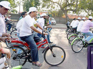 Delhi Chief Minister Arvind Kejriwal participates in a cycle-rally from Red Fort to Bhagwan Das Marg to observe 'Car-Free Day' in New Delhi.