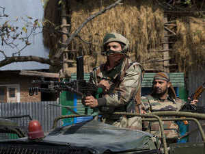 In pic: Army soldiers atop a vehicle arrive at the site of a gunbattle with suspected militants in Bungham village, Kashmir, on Oct. 21, 2015