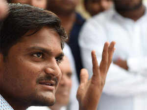 Gujarat Congress today came out in support of the Patel quota agitation leader Hardik Patel by saying that registration of sedition cases against him was an attempt to crush the reservation stir.