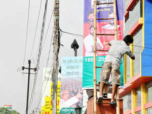 All major locations and landmarks in the city are splashed with political colours, with BJP apparently a decibel up in the poster wars.