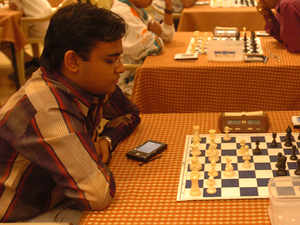 Abhijeet Gupta justified his top billing as he won the Hoogeveen International after defeating compatriot Neelotpal Das in the ninth and final round here.