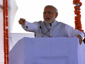 """Blaming """"Bade bhaai (Lalu) and Chhote Bhaai (Nitish Kumar) for problems plaguing the state, Modi insisted that the only plank NDA has is of """"development""""."""