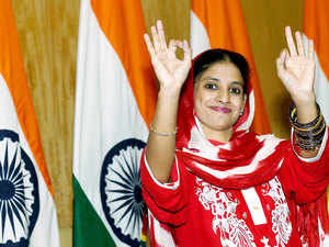 Geeta, a deaf-mute Indian woman who accidentally crossed over to Pakistan more than a decade ago gestures at a press conference in New Delhi on Monday.