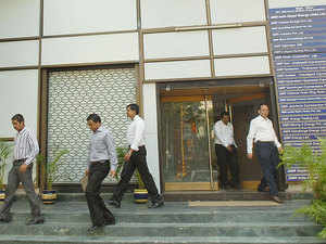 """The government will """"shortly"""" unveil the roadmap for phased reduction of corporate tax rate to 25 per cent from 30 per cent at present, Revenue Secretary Hasmukh Adhia said."""
