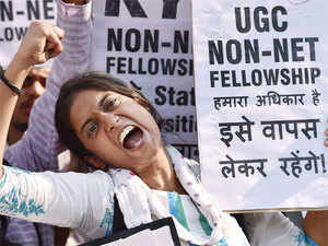 Amid unrelenting protests by students against the scrapping of the non-NET fellowship by the University Grants Commission, the government today appointed a five-member panel to review the research grants offered by UGC which has been asked to continue all existing grants