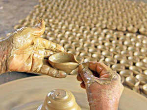 A potter busy in making earthen lamps ahead of the Diwali festival at Narayanpur in Birbhum district of West Bengal.
