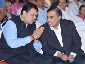 Maharashtra Chief Minister Devendra Fadnavis interacts with industrialist Mukesh Ambani during the opening ceremony of 17th edition of Jio MAMI Mumbai Film Festival, in Mumbai.