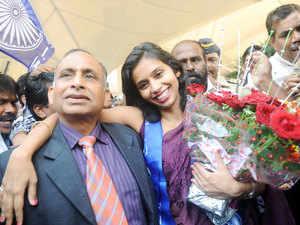 Indian diplomat Devyani Khobragade accompanied by her father Uttam Khobragade arrives at the Santacruz domestic airport in Mumbai.