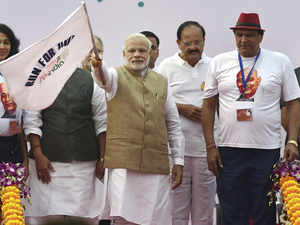 Prime Minister Narendra Modi flags off the 'Run for Unity', on the occasion of the 140th birth anniversary of Sardar Vallabhbhai Patel, in New Delhi on Saturday.