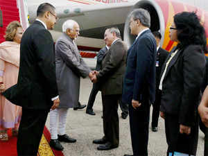 Vice President Hamid Ansari and his wife Salma Ansari being received by officials upon their arrival at Jakarta airport in Indonesia.