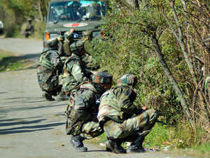 In pic: Army personnel in action during an encounter operation against militants in Khandaypora, in Kulgam District of South Kashmir.