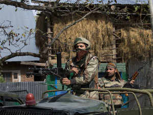 In pic: Indian army soldiers atop a vehicle arrive at the site of a gunbattle with suspected rebels in Bungham village, Kashmir.
