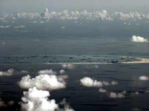 File photo taken through Philippine military plane shows the alleged on-going land reclamation by China on mischief reef in the Spratly Islands.