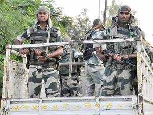 Border Security Force personnel has arrested two Bangladeshi nationals with seven Indian passports in their possession, a BSF official today said.