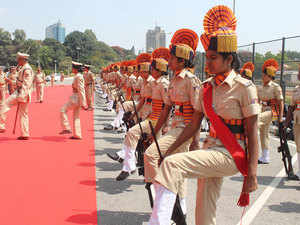 File photo: Women cops of Karnataka State Industrial Security Force (KSISF) giving gaurd of honour to Chief Minister Siddaramaiah.