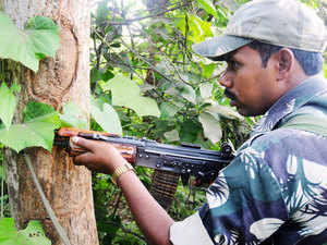 In pic: A Police personal guards cordon on the spot at Amlatand, a village in Maoist-infested Kathikund area June 3, 2013.