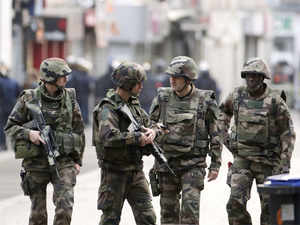 In pic: French soldiers stand guard in the northern Paris suburb of Saint-Denis city center