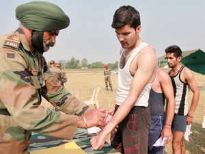 In pic: An Indian Army soldier stamps a candidate selected during a recruitment rally at Sunjwan Military station on the outskirts of Jammu