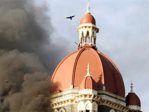 In this file photograph taken on November 27, 2008, flames and smoke gush out of The Taj Mahal Hotel, one of the sites of 26/11 Mumbai attacks.