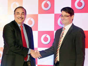 Vodafone India CEO & MD Sunil Sood shaking hand with Vodafone India CFO Thomas Reisten, during a press conference to announce financial results of the company in Mumbai.