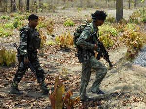 (In pic) CRPF jawans patrolling at Dantewada in Chattisgarh.
