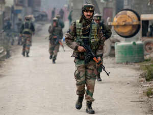 In pic: Indian army soldiers patrol during a search operation in Pampore, south of Srinagar