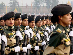 Women contingent of the Border Security Force (BSF) march in a parade during golden jubilee celebrations of their raising day in New Delhi, India.