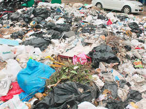 Heaps of garbage was seen piled up on busy church street in Bengaluru on November 8, 2015.