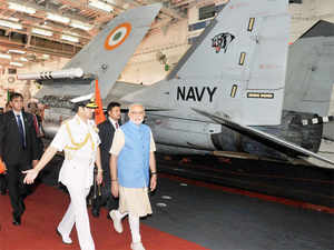 PM Modi with Chief of Naval Staff, Admiral RK Dhowan visiting the INS Vikramaditya, in Kochi.