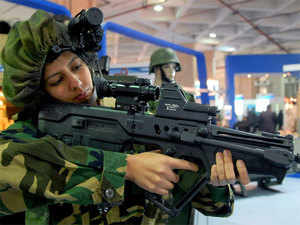 (In pic) An woman infantry soldier displays the working of a TAVOR rifle mounted with night vision devices in New Delhi.