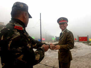 Incursion bids by Chinese People's Liberation Army reduced more than 15 per cent since 2014.  In pic: A Chinese soldier shares light moment with an Indian officer at Nathu La on the India-China border.